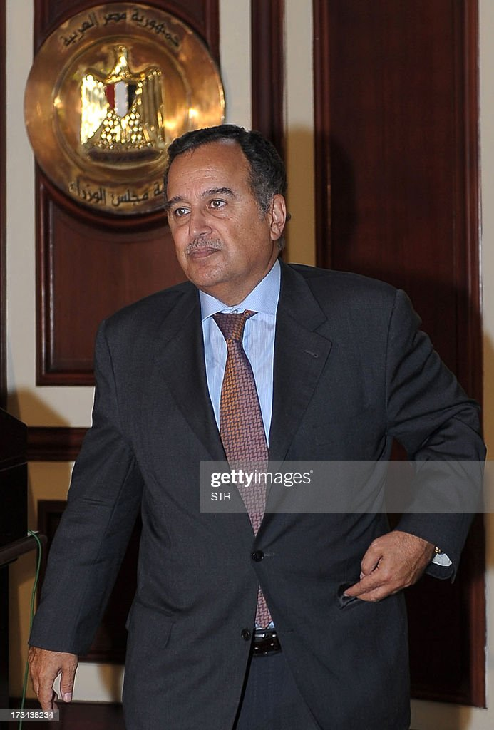 Egypt's newly appointed foreign minister Nabil Fahmy leaves following a meeting with caretaker prime minister Hazem al-Beblawi in Cairo on July 14, 2013. Fahmy, a former ambassador to the United States, accepted the post of foreign minister in Egypt's new cabinet, which replaces ousted president Mohamed Morsi's government, sources said. AFP PHOTO / STR
