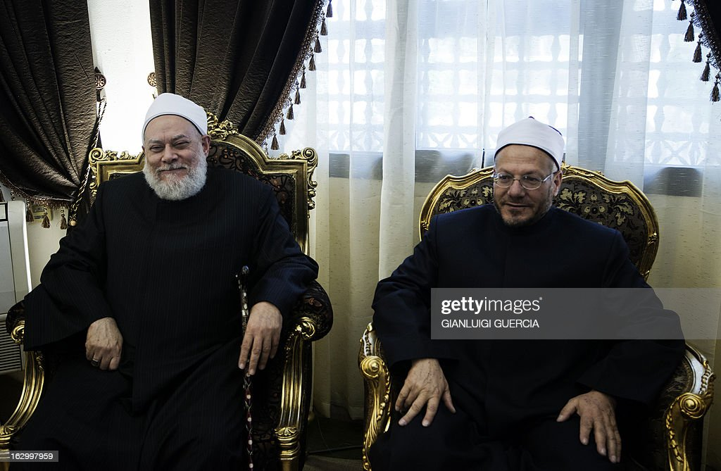 Egypt's newly appointed Grand Mufti Shawqi Abdel Karim (R) meets with his predecessor Ali Gomaa at Al-Azhar compound in Cairo on March 3, 2013. Clerics of Al-Azhar elected the new mufti, or Egypt's leading interpreter of Islamic law, in an unprecedented vote signalling the Islamic institute's growing independence from the government.