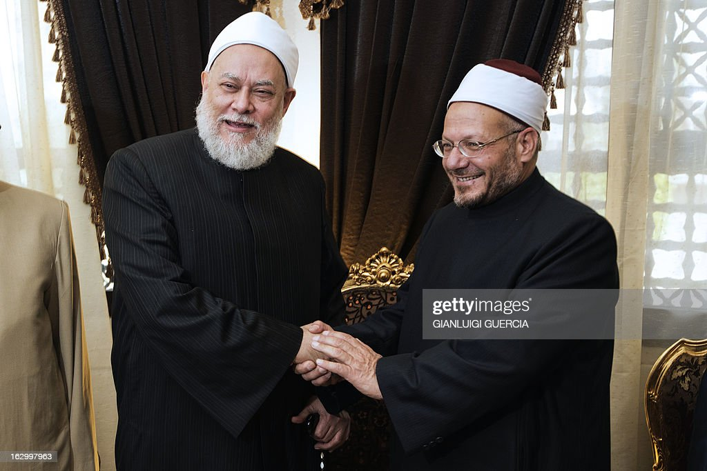 Egypt's newly appointed Grand Mufti Shawqi Abdel Karim (R) meets with his predecessor Ali Gomaa at Al-Azhar compound in Cairo on March 3, 2013. Clerics of Al-Azhar elected the new mufti, or Egypt's leading interpreter of Islamic law, in an unprecedented vote signalling the Islamic institute's growing independence from the government. AFP PHOTO/GIANLUIGI GUERCIA