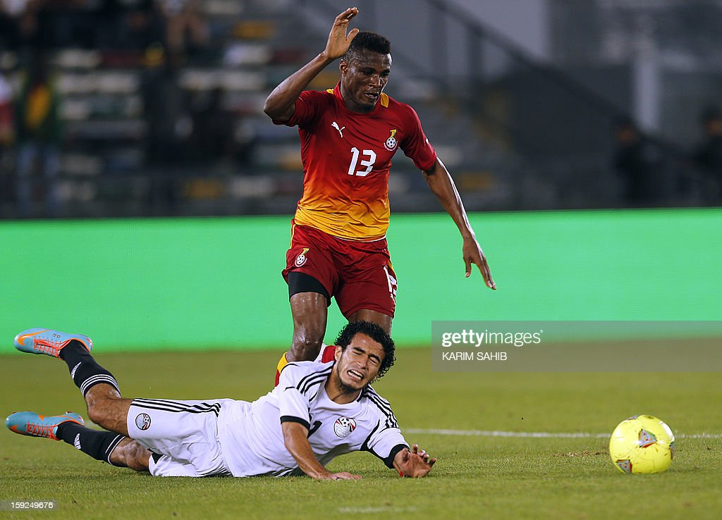 Egypt's Omar Gaber (bottom) fights for the ball against Ghana's Jerry Akaminko (R) during their friendly football match in Abu Dhabi on January 10, 2013.