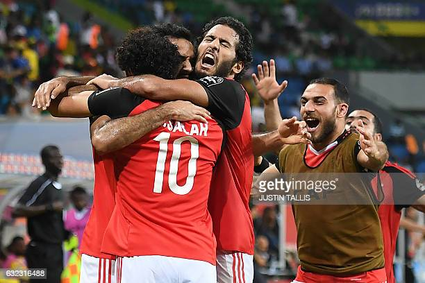 TOPSHOT Egypt's players celebrate a goal during the 2017 Africa Cup of Nations group D football match between Egypt and Uganda in PortGentil on...
