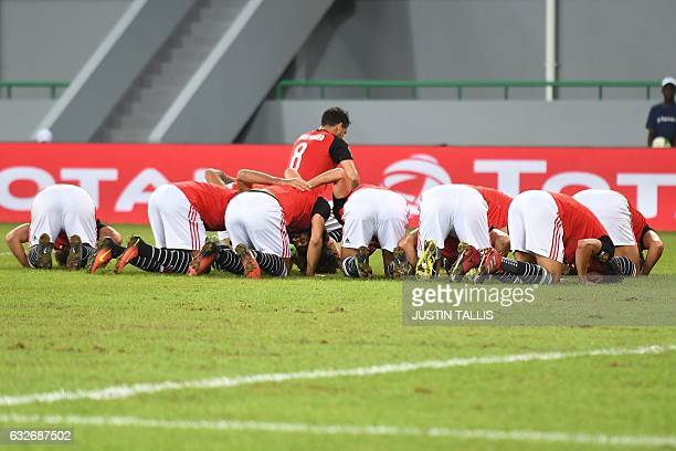 TOPSHOT Egypt's players celebrate a goal during the 2017 Africa Cup of Nations group D football match between Egypt and Ghana in PortGentil on...