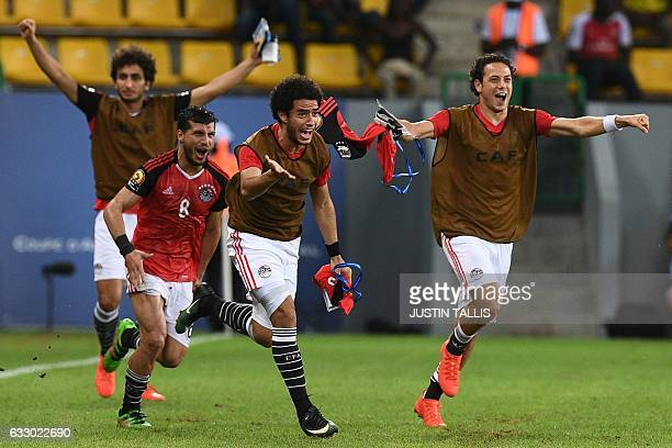 Egypt's players celebrate at the end of the 2017 Africa Cup of Nations quarterfinal football match between Egypt and Morocco in PortGentil on January...