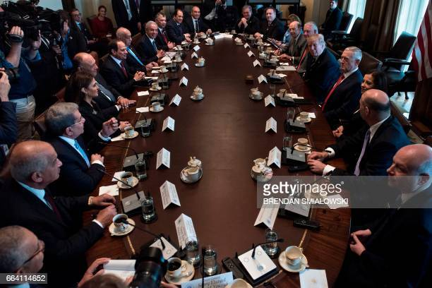 Egypt's President Abdel Fattah alSisi and US President Donald Trump wait with staff for a meeting in the Cabinet Room of the White House April 3 2017...