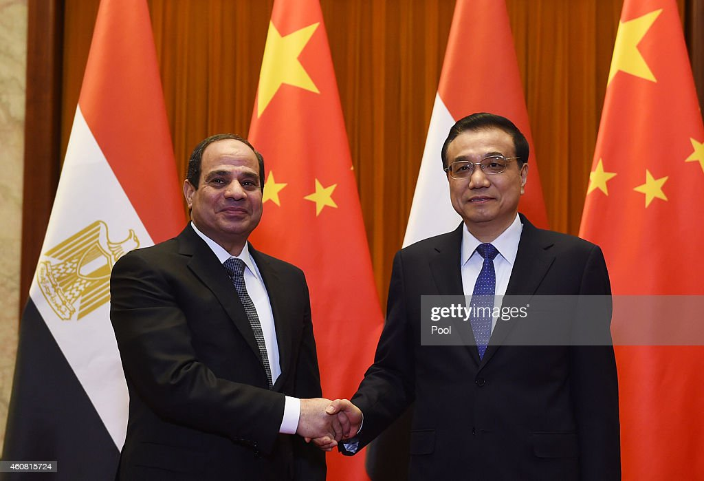 Egypt's President Abdel Fattah al-Sisi (L) chats with Chinese Premier <a gi-track='captionPersonalityLinkClicked' href=/galleries/search?phrase=Li+Keqiang&family=editorial&specificpeople=2481781 ng-click='$event.stopPropagation()'>Li Keqiang</a> in the Great Hall of the People on December 24, 2014 in Beijing, China. Egyptian President Abdel Fattah al-Sisi was on the second day of a state visit to China.