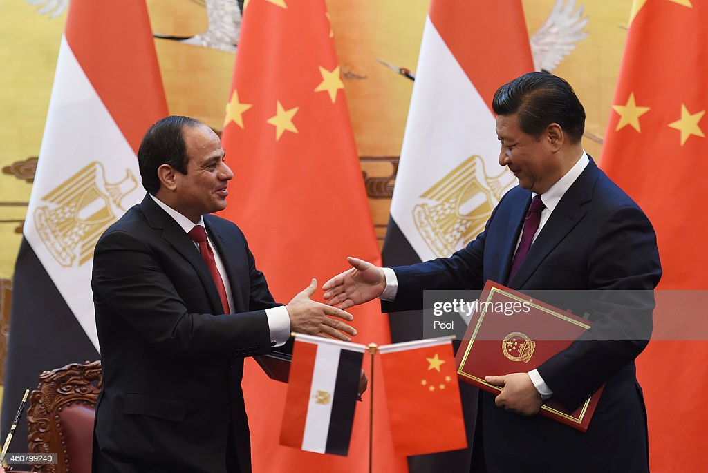Egypt's President Abdel Fattah al-Sisi (L) greets Chinese President <a gi-track='captionPersonalityLinkClicked' href=/galleries/search?phrase=Xi+Jinping&family=editorial&specificpeople=2598986 ng-click='$event.stopPropagation()'>Xi Jinping</a> (R) during a signing ceremony at the Great Hall of the People on December 23, 2014 in Beijing, China. President Abdel Fattah al-Sisi is undertaking his first visit to China in hopes to secure investment deals.