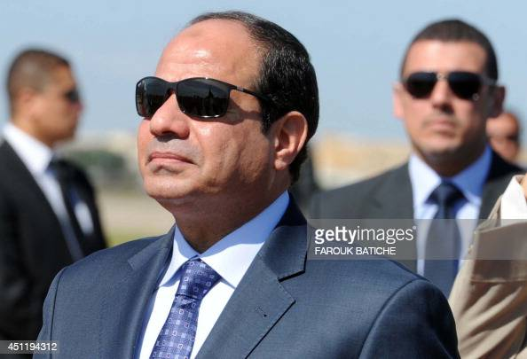 Egypt's president Abdel Fattah alSisi reviews troops upon his arrival at HouariBoumediene International Airport on June 25 2014 in Algiers Sisi...