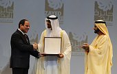 Egypt's President Abdel Fattah alSisi shakes hands with Sheikh Mohammed bin Zayed alNahyan Crown Prince of Abu Dhabi and the UAE's deputy...