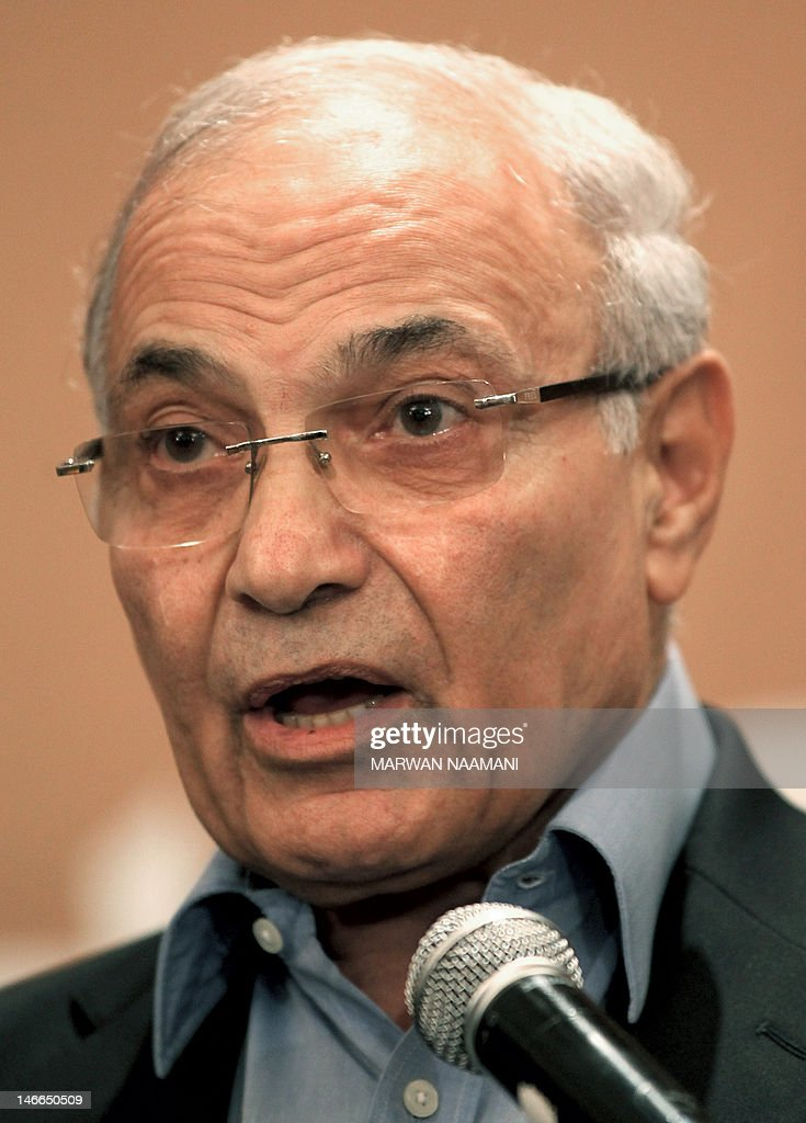 Egypt's presidential candidate Ahmed Shafiq, the last premier of ousted Egyptian strongman Hosni Mubarak, speaks during a press conference in Cairo, on June 21, 2012. Egypt on Thursday braced for a showdown between the military and the Muslim Brotherhood as the electoral commission delayed announcing the winner of a presidential poll claimed by the Islamists. A delay in announcing the results from the run-off, which had been due on Thursday, heightened fears of a 'soft coup' by the ruling military, which has already disbanded the Islamist-led parliament and granted itself sweeping powers. AFP PHOTO/MARWAN NAAMANI