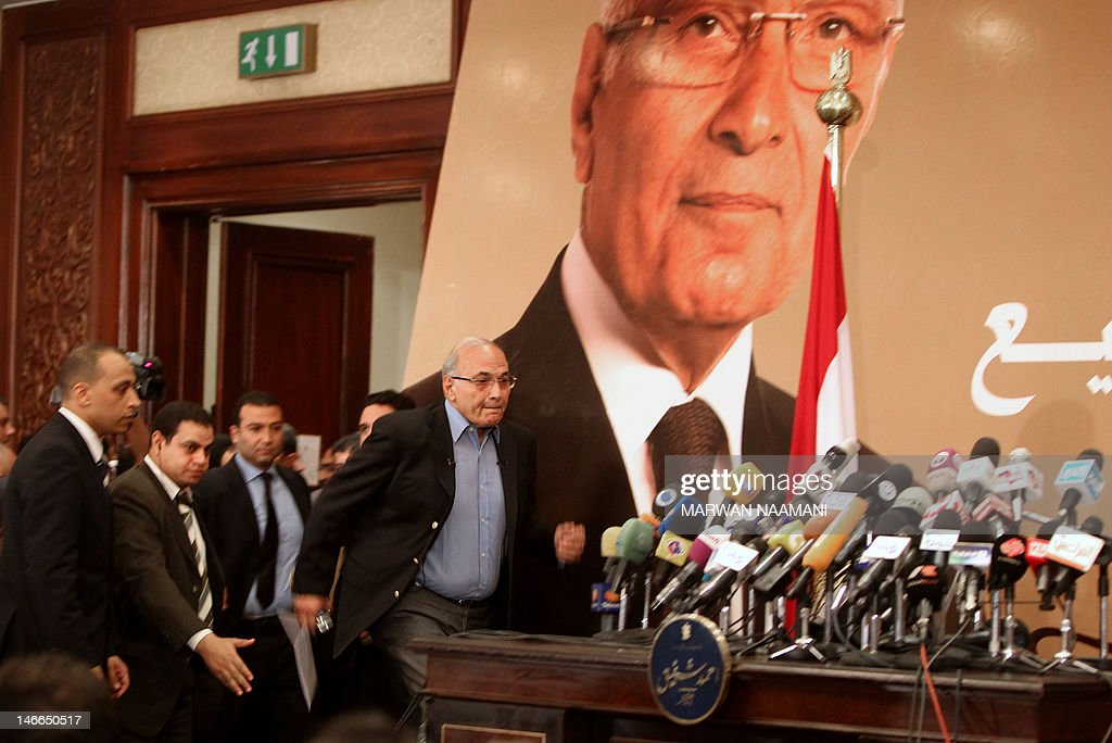 Egypt's presidential candidate Ahmed Shafiq, the last premier of ousted Egyptian strongman Hosni Mubarak, arrives for a press conference in Cairo, on June 21, 2012. Egypt on Thursday braced for a showdown between the military and the Muslim Brotherhood as the electoral commission delayed announcing the winner of a presidential poll claimed by the Islamists. A delay in announcing the results from the run-off, which had been due on Thursday, heightened fears of a 'soft coup' by the ruling military, which has already disbanded the Islamist-led parliament and granted itself sweeping powers.