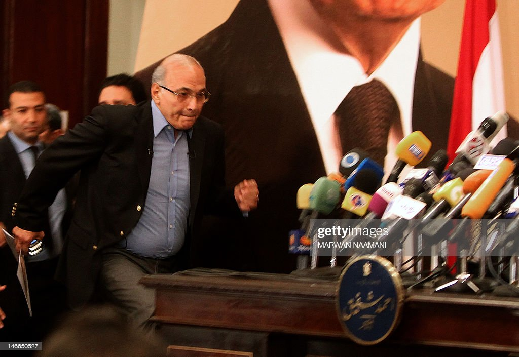 Egypt's presidential candidate Ahmed Shafiq, the last premier of ousted Egyptian strongman Hosni Mubarak, arrives for a press conference in Cairo, on June 21, 2012. Egypt on Thursday braced for a showdown between the military and the Muslim Brotherhood as the electoral commission delayed announcing the winner of a presidential poll claimed by the Islamists. A delay in announcing the results from the run-off, which had been due on Thursday, heightened fears of a 'soft coup' by the ruling military, which has already disbanded the Islamist-led parliament and granted itself sweeping powers. AFP PHOTO/MARWAN NAAMANI