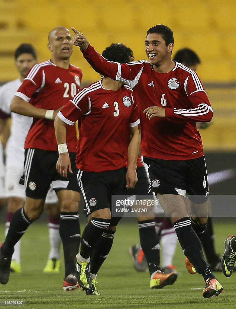 Egypt's Ramy Rabia (R) is congratulated by teammates after scoring a first goal during the friendly football Qatar versus Egypt in the Qatari capital Doha on March 7, 2013. The match comes in the frame of the both national teams preparation for Asian and African qualification rounds for FIFA 2014 World Cup Finals in Brazil.