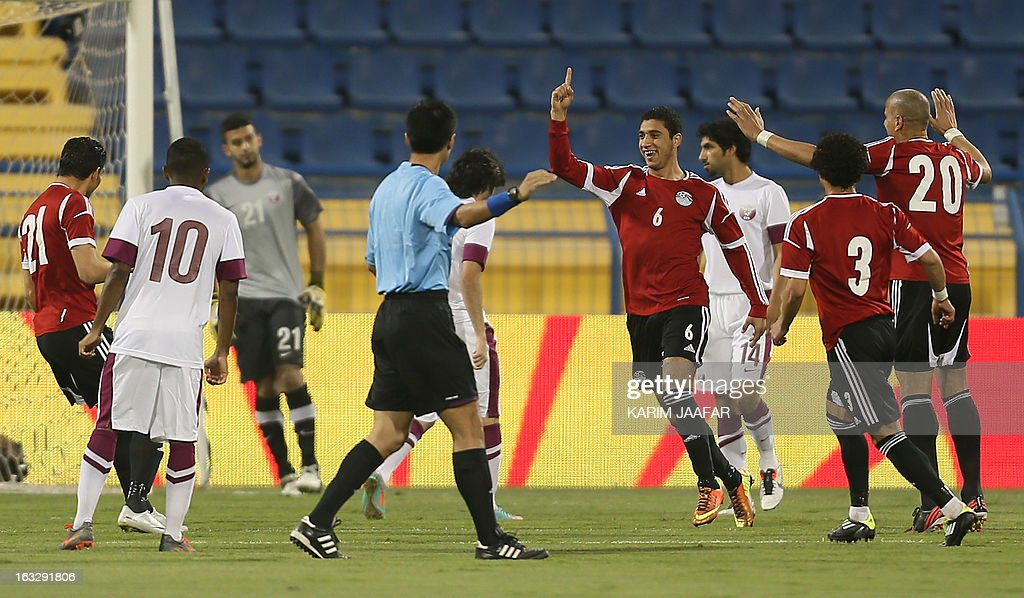 Egypt's Ramy Rabia (3rdR) is congratulated by teammates after scoring a goal during the friendly football Qatar versus Egypt in the Qatari capital Doha on March 7, 2013. The match comes in the frame of the both national teams preparation for Asian and African qualification rounds for FIFA 2014 World Cup Finals in Brazil.