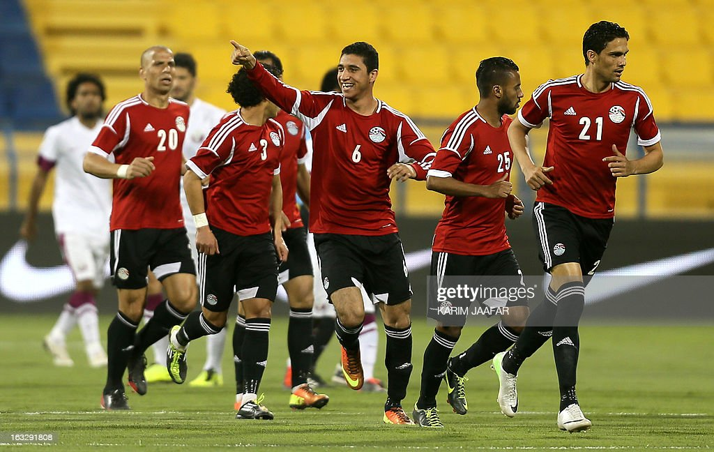 Egypt's Ramy Rabia (C) is congratulated by teammates after scoring a goal during the friendly football Qatar versus Egypt in the Qatari capital Doha on March 7, 2013. The match comes in the frame of the both national teams preparation for Asian and African qualification rounds for FIFA 2014 World Cup Finals in Brazil.