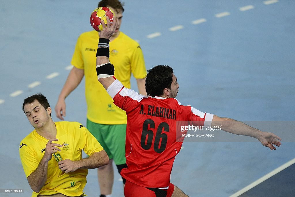 Egypt's right back Ahmed Mostafa (L) shoots past Australia's centre back Caleb Gahan during the 23rd Men's Handball World Championships preliminary round Group D match Egypt vs Australia at the Caja Magica in Madrid on January 19, 2013.