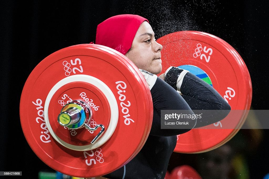 Egypt's Sara Ahmed competes in the clean and jerk portion of the women's 69kg weightlifting competition at the 2016 summer Olympic Games in Rio de...
