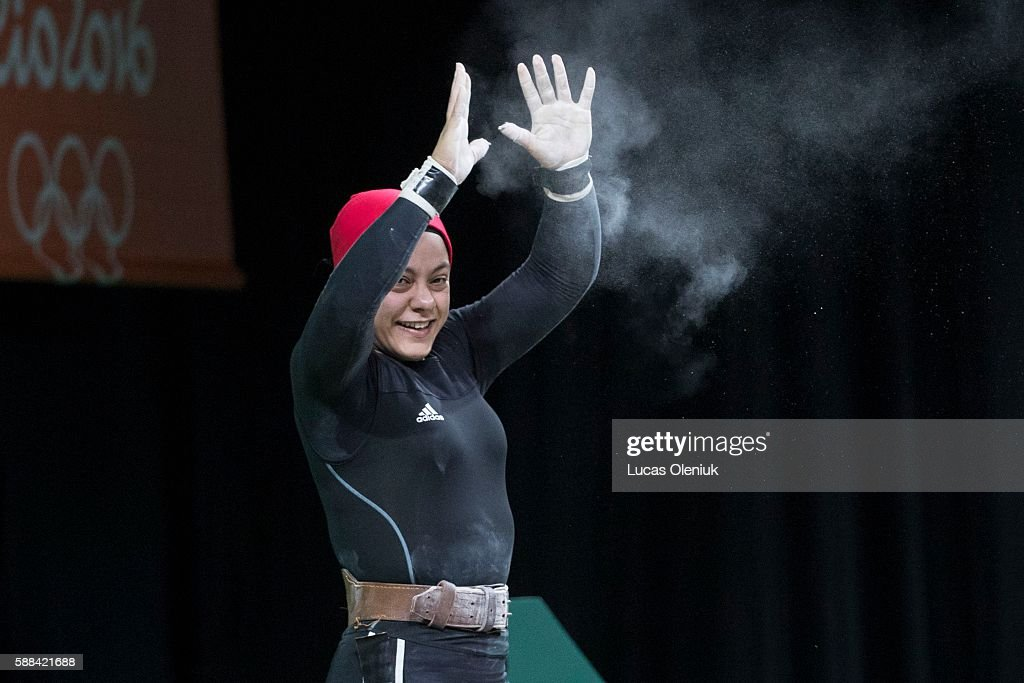 Egypt's Sara Ahmed creactes after lifting 143kg's in the clean and jerk portion of the women's 69kg weightlifting competition at the 2016 summer...