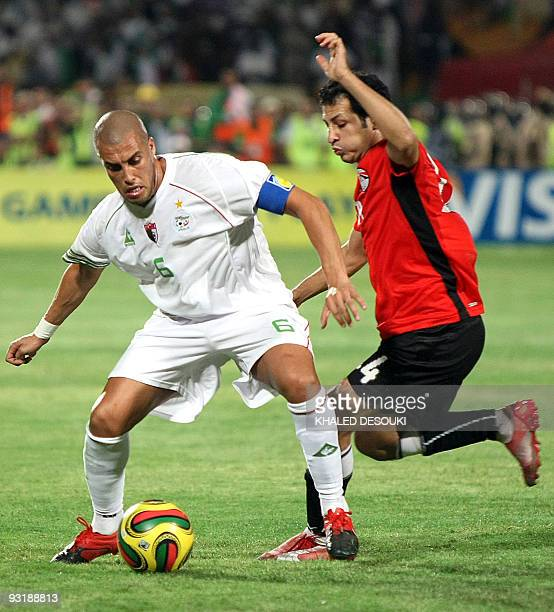 Egypt's Sayed Moawad challenges Algeria's Yazid Mansouri during their 2010 World Cup qualifying playoff football match in Khartoum on November 18...
