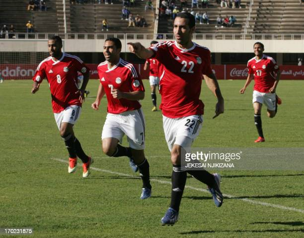 Egypt's striker Aboutrika Salaire celebrates with his teammates after scoring the opening goal of their 2014 World Cup qualifier match against...