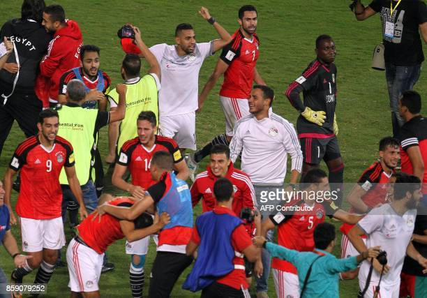 Egypt's team players celebrate wining against Congo's team during their World Cup 2018 Africa qualifying match between Egypt and Congo at the Borg...
