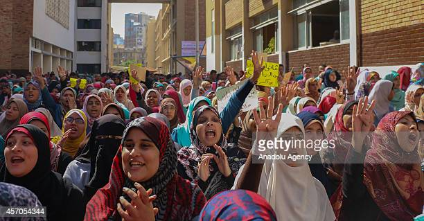 Egytian students make Rabaa sign and chant slogans as they hold an anticoup protest in Alexandria University in Egypt on October 11 2014