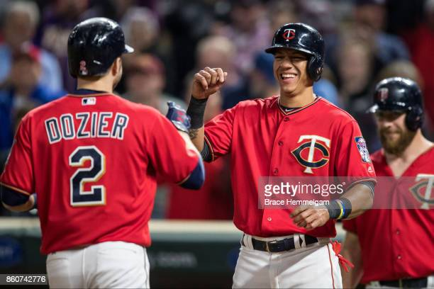 Ehire Adrianza of the Minnesota Twins celebrates with Brian Dozier against the Detroit Tigers on September 29 2017 at Target Field in Minneapolis...