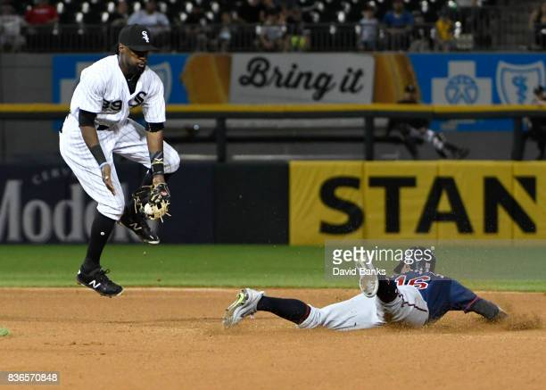 Ehire Adrianza of the Minnesota Twins steals second base as Alen Hanson of the Chicago White Sox takes the throw during the fourth inning in game two...