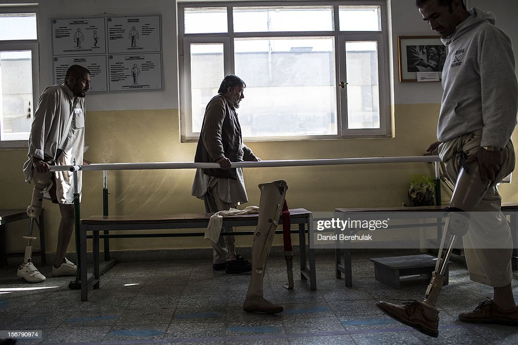 Ehsamullah, 30, (L) who lost his leg after being shot with an AK-47 and Hassibullah, 30, (R)who lost his after stepping on a mine, practice walking with their prosthetic limbs at the International Committee of the Red Cross (ICRC), orthopedic centre on November 20, 2012 in Kabul, Afghanistan. The ICRC rehabilitation centre works to educate and rehabilitate land-mine victims, and those with limb related deformities, back into society and employment offering micro-credit financing, home schooling and vocational training to patients. The clinic itself is unique in that all of the workers are handicapped. The ICRC centre in Kabul has registered over 57,000 patients and 114,000 countrywide in all of their centres since its inception 25 years ago.