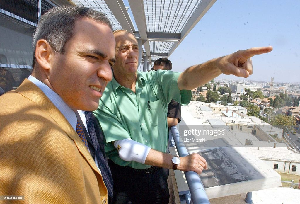 <a gi-track='captionPersonalityLinkClicked' href=/galleries/search?phrase=Ehud+Olmert&family=editorial&specificpeople=178946 ng-click='$event.stopPropagation()'>Ehud Olmert</a> mayor of Jerusalem(R) point his hand towards the Dome of the rock next to Former world chess champion <a gi-track='captionPersonalityLinkClicked' href=/galleries/search?phrase=Garry+Kasparov&family=editorial&specificpeople=171112 ng-click='$event.stopPropagation()'>Garry Kasparov</a> in Jerusalem on Wednesday August 7, 2002. Kasparov will face the 'Junior' chess program designed by Shay Bushinsky, in a match to take place in Jerusalem at the beginning of October 2002.