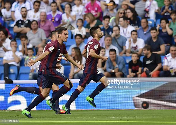Eibar players celebrate after scoring a goal during the Spanish league football match Real Madrid CF vs SD Eibar at the Santiago Bernabeu stadium in...