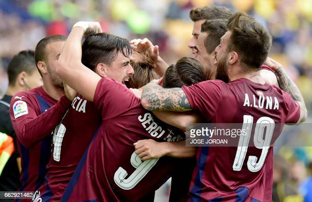 Eibar players celebrate their third goal during the Spanish league football match Villarreal CF vs SD Eibar at Estadio de la Ceramica in Vilareal on...