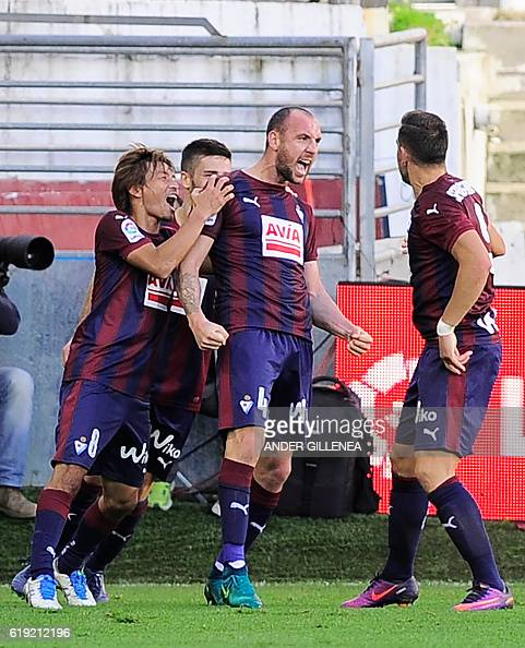 Eibar's defender Ivan Ramis celebrrates with teammates after scoring his team's first goal during the Spanish league football match between SD Eibar...