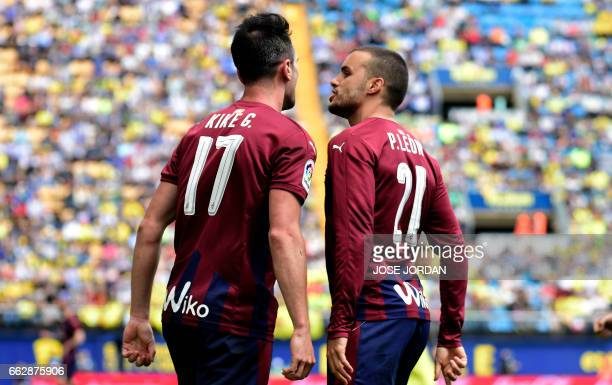 Eibar's forward Kike Garcia celebrates a goal with teammate forward Pedro Leon during the Spanish league football match Villarreal CF vs SD Eibar at...