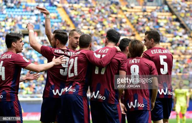 Eibar's forward Kike Garcia celebrates a goal with teammates during the Spanish league football match Villarreal CF vs SD Eibar at Estadio de la...