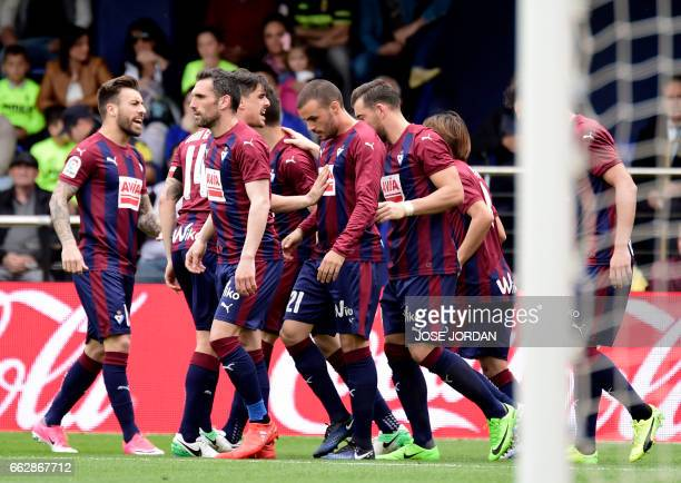 Eibar's forward Pedro Leon celebrates a goal with teammates during the Spanish league football match Villarreal CF vs SD Eibar at Estadio de la...