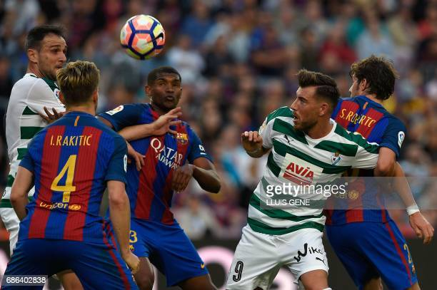 Eibar's forward Sergi Enrich vies with Barcelona's defender Brazilian Defender Marlon during the Spanish league football match FC Barcelona vs SD...