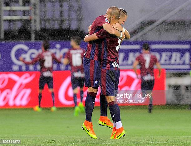 Eibar's French defender Florian Lejeune and defender Alejandro Galvez celebrate a goal scoring during the Spanish league football match SD Eibar vs...