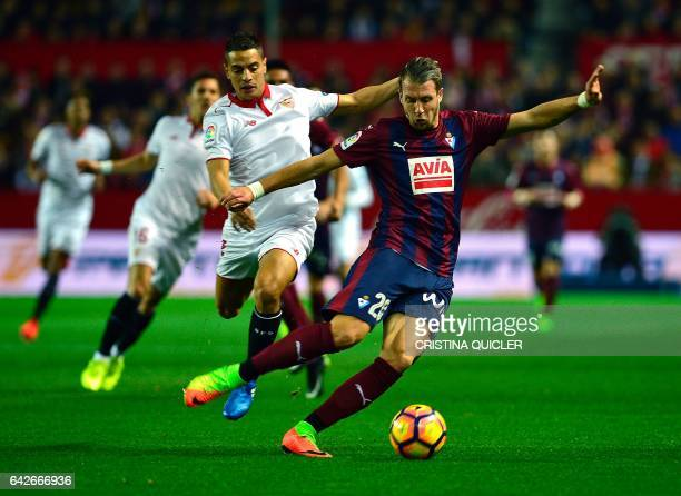 CORRECTION Eibar's French defender Florian Lejeune vies with Sevilla's French forward Wissam Ben Yedder during the Spanish league football match...