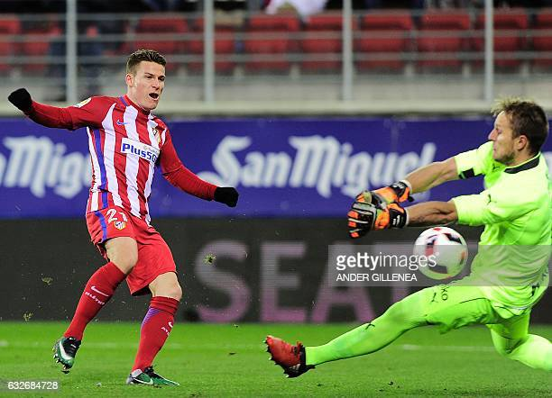 Eibar's goalkeeper Yoel Rodriguez tries to stop a shot by Atletico Madrid's French forward Kevin Gameiro during the Spanish Copa del Rey quarter...