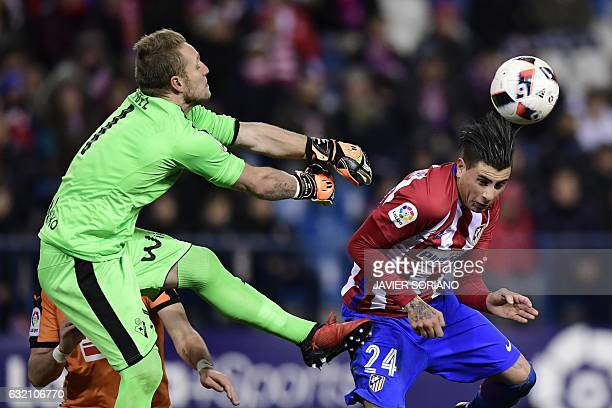Eibar's goalkeeper Yoel Rodriguez vies with Atletico Madrid's Uruguayan defender Jose Maria Gimenez during the Spanish Copa del Rey quarter final...