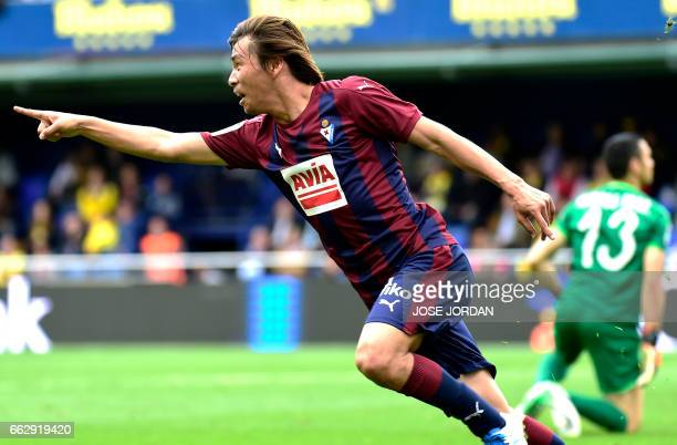 Eibar's Japanese midfielder Takashi Inui celebrates a goal during the Spanish league football match Villarreal CF vs SD Eibar at Estadio de la...
