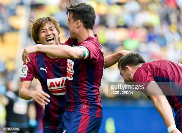 Eibar's Japanese midfielder Takashi Inui celebrates a goal with Eibar's midfielder Daniel Garcia Carrillo during the Spanish league football match...