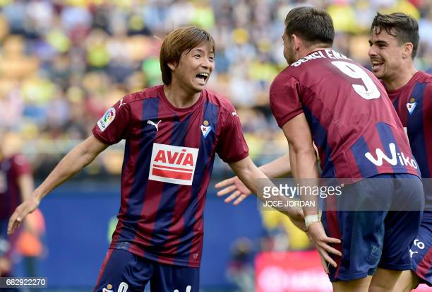 Eibar's Japanese midfielder Takashi Inui celebrates a goal with Eibar's forward Sergi Enrich and Eibar's midfielder Daniel Garcia Carrillo during the...