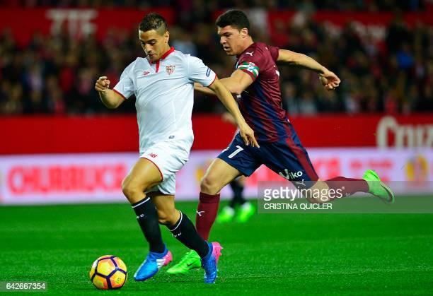 Eibar's midfielder Ander Capa Rodriguez vies with Sevilla's French forward Wissam Ben Yedder during the Spanish league football match Sevilla FC vs...