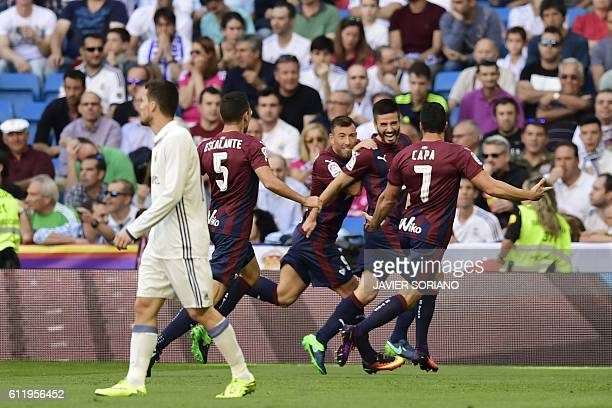 Eibar's midfielder Eibar players celebrate after scoring a goal during the Spanish league football match Real Madrid CF vs SD Eibar at the Santiago...