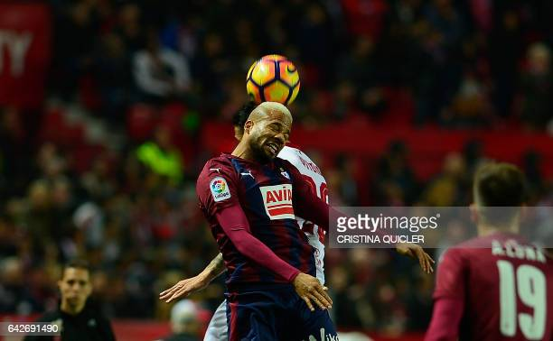 Eibar's Portuguese forward Tiago Manuel Dias Correia 'Bebe' heads the ball during the Spanish league football match Sevilla FC vs SD Eibar on...