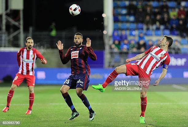 Eibar's Portuguese forward Tiago Manuel Dias Correia vies with Atletico Madrid's midfielder Gabi during the Spanish Copa del Rey quarter final second...