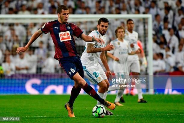 Eibar's Spanish midfielder Christian Rivera challenges Real Madrid's Spanish midfielder Daniel Ceballos during the Spanish league football match Real...