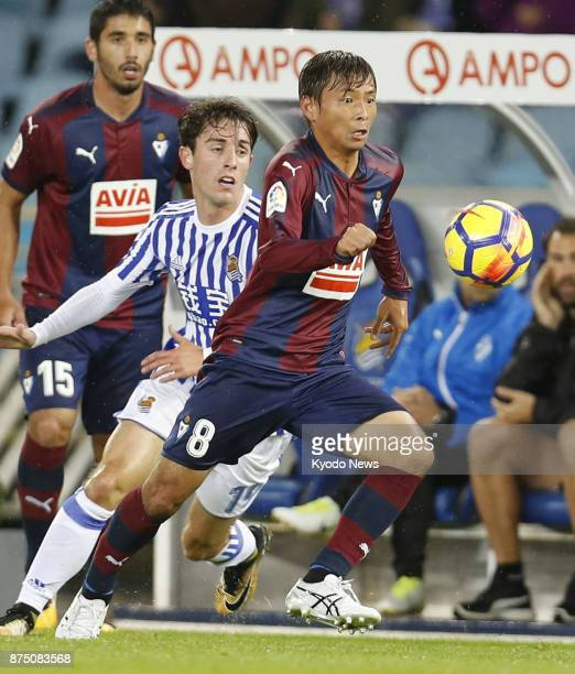 Eibar's Takashi Inui pursues the ball as he is marked by Alvaro Odriozola of Real Sociedad during the first half of a Spanish La Liga match at...