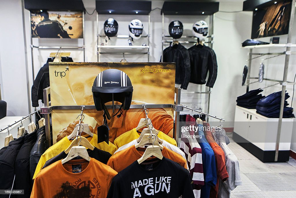 Eicher Motors Ltd. Royal Enfield-branded merchandise are displayed for sale at the company's Royal Enfield flagship dealership in Gurgaon, India, on Monday, May 20, 2013. The Indian maker of Royal Enfield, the World War II-era British motorcycle owned by stars including Brad Pitt, plans to export the vehicles to Southeast Asia and Latin America as it builds on record sales at home. Photographer: Prashanth Vishwanathan/Bloomberg via Getty Images